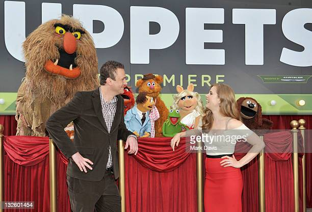 Screenwriter and Executive Producer Jason Segel and actress Amy Adams arrive at the premiere of Walt Disney Pictures' The Muppets held at the El...