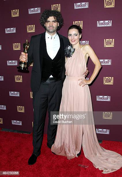 Screenwriter Armando Bo and guest attend the 21st Century Fox and Fox Searchlight Oscar Party at BOA Steakhouse on February 22 2015 in West Hollywood...