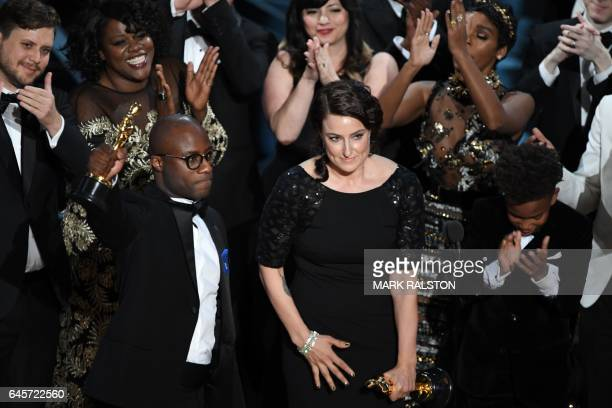 TOPSHOT US screenwriter Barry Jenkins celebrates after Moonlight won the Best Film award at the 89th Oscars on February 26 2017 in Hollywood...
