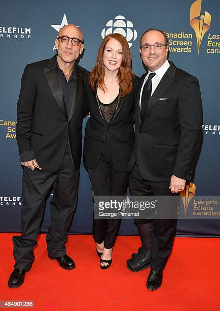 Screenwriter Bruce Wagner actress Julianne Moore and President of the Academy of Canadian Cinema and Television Martin Katz arrive at the 2015...