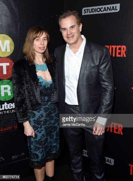 Screenwriter Byron Willinger and guest attend the 'The Commuter' New York Premiere at AMC Loews Lincoln Square on January 8 2018 in New York City
