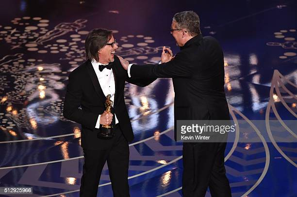 Screenwriter Charles Randolph and screenwriterdirector Adam McKay accept the Best Adapted Screenplay award for 'The Big Short' onstage during the...