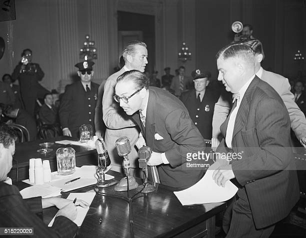 Screenwriter Dalton Trumbo one of the Hollywood Ten targeted by the UnAmerican Activities Committee leaves the witness stand shouting This is the...