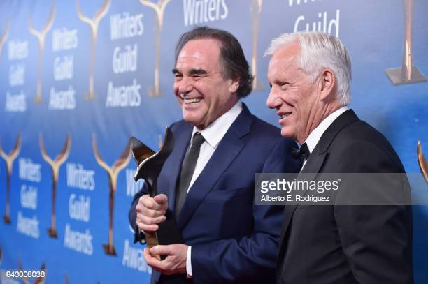 Screenwriter /Director Oliver Stone and actor James Woods pose with the Laurel Award for Screenwriting Achievement during the 2017 Writers Guild...