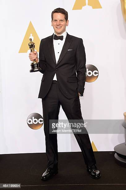 Screenwriter Graham Moore winner of the Best Adapted Screenplay Award for 'The Imitation Game' poses in the press room during the 87th Annual Academy...