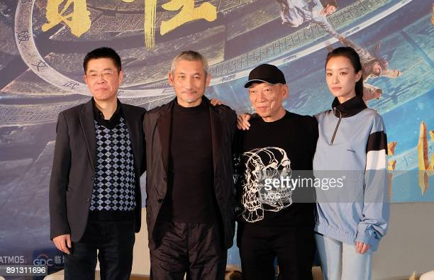 Screenwriter Hark Tsui director Yuen Wooping and actress Ni Ni promote film 'The Thousand Faces of Dunjia' on December 12 2017 in Wuhan Hubei...