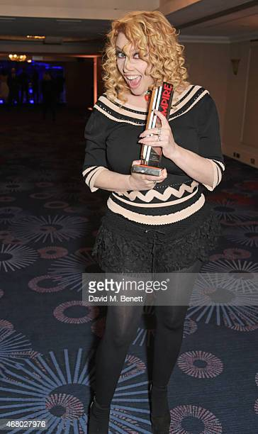 Screenwriter Jane Goldman poses in the Winners Room with the award for Best British Film for 'Kingsman The Secret Service' at the Jameson Empire...