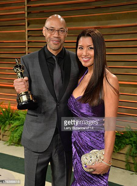 Screenwriter John Ridley and Gayle Ridley attend the 2014 Vanity Fair Oscar Party Hosted By Graydon Carter on March 2 2014 in West Hollywood...