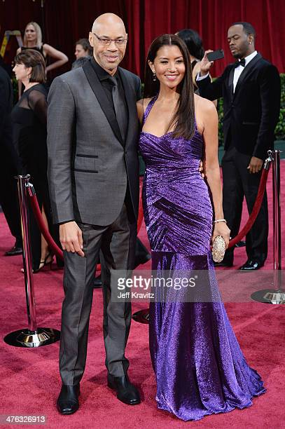 Screenwriter John Ridley and Gayle Ridley attend the Oscars held at Hollywood Highland Center on March 2 2014 in Hollywood California