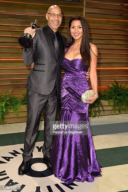 Screenwriter John Ridley and Gayle Ridley attends the 2014 Vanity Fair Oscar Party hosted by Graydon Carter on March 2 2014 in West Hollywood...
