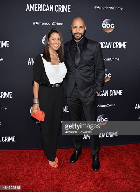 Screenwriter John Ridley and his wife Gayle Ridley arrive at the American Crime premiere event at the Ace Hotel on February 28 2015 in Los Angeles...