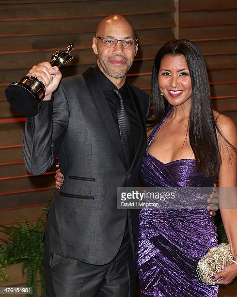 Screenwriter John Ridley and wife Gayle Ridley attend the 2014 Vanity Fair Oscar Party hosted by Graydon Carter on March 2 2014 in West Hollywood...