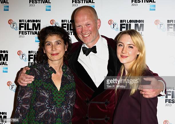 Screenwriter Jonathan Asser, winner of the Best British Newcomer award with Jury President Amanda Posey and award presenter Saorise Ronan at the BFI...