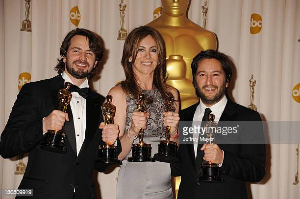 Screenwriter Mark Boal director Kathryn Bigelow and producer Greg Shapiro and winners of the Best Picture award for 'The Hurt Locker' pose in the...