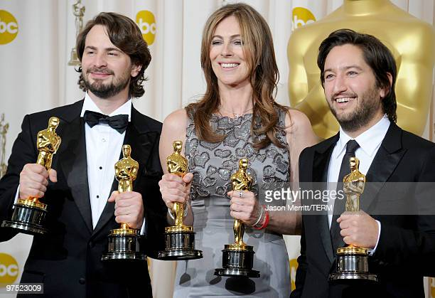 Screenwriter Mark Boal director Kathryn Bigelow and producer Greg Shapiro winners of the Best Picture award for The Hurt Locker pose in the press...
