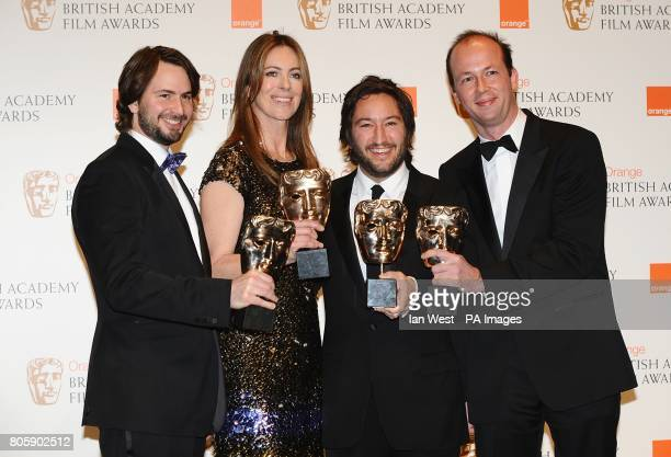 Screenwriter Mark Boal director Kathryn Bigelow producer Greg Shapiro and producer Nicholas Chartier with the Film award received for The Hurt Locker...