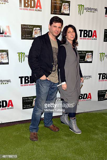 Screenwriter Max Brooks and wife Michelle attend the Lyme Light Benefit Concert at El Rey Theatre on May 1 2014 in Los Angeles California