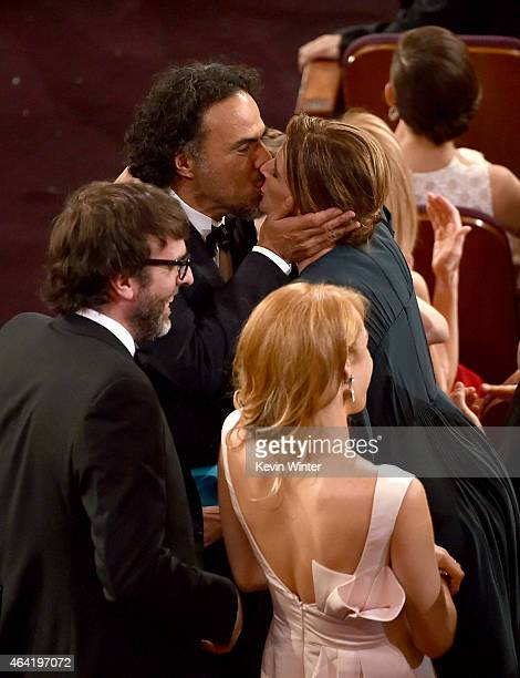 Screenwriter Nicolas Giacobone director Alejandro Gonzalez Inarritu with Maria Eladia Hagerman accept the Best Picture award for 'Birdman' onstage...