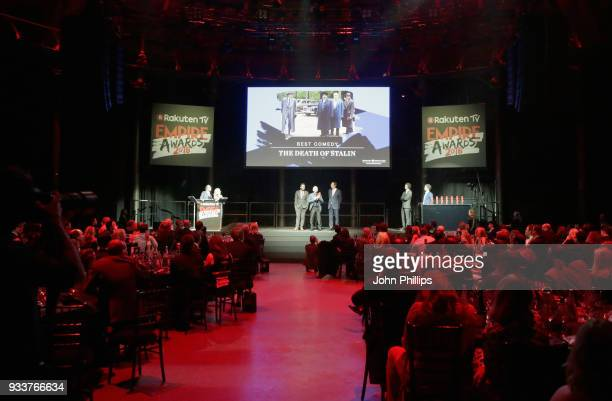 Screenwriter Peter Fellows actor Armando Iannucci and producer Kevin Loader receive the award for Best Comedy for 'Death of Stalin' on stage during...