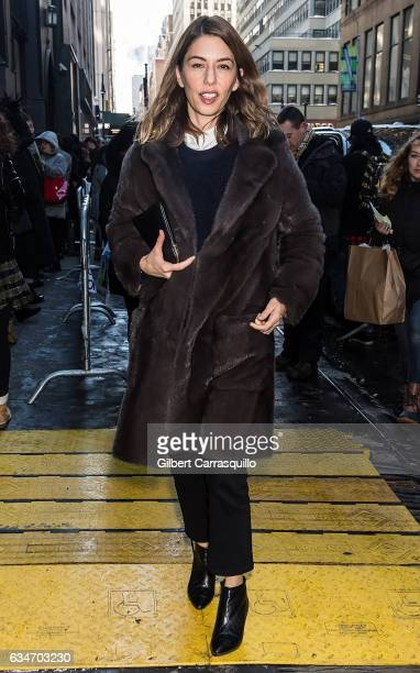 Screenwriter Sofia Coppola is seen arriving at the Calvin Klein Collection fashion show with new chief creative officer Raf Simons during New York...