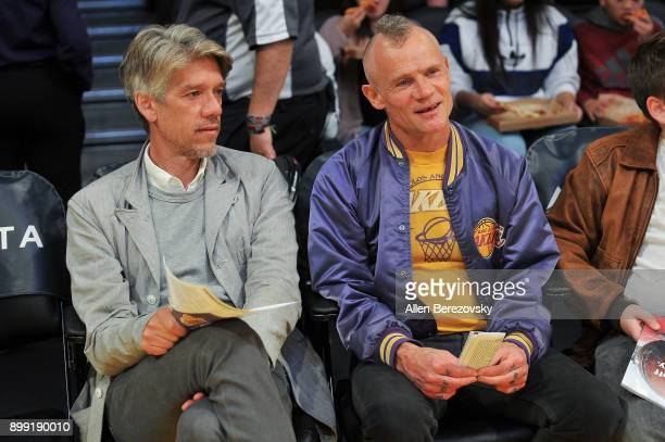 Screenwriter Stephen Gaghan and musician Flea attend a basketball game between the Los Angeles Lakers and the Memphis Grizzlies at Staples Center on...