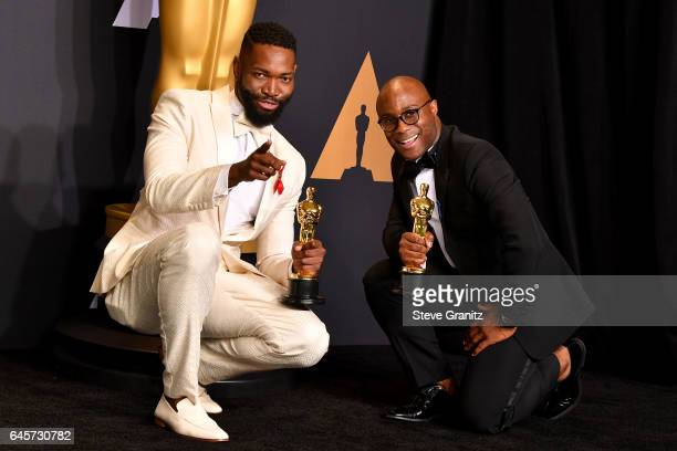 Screenwriter Tarell Alvin McCraney and filmmaker Barry Jenkins winners of the award for Adapted Screenplay for 'Moonlight' pose in the press room...