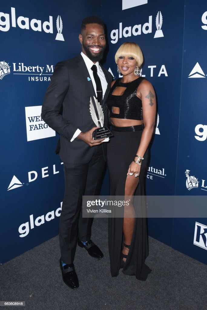Screenwriter Tarell Alvin McCraney (L) and singer Mary J. Blige pose with the Outstanding Film - Wide Release award for 'Moonlight' during the 28th Annual GLAAD Media Awards in LA at The Beverly Hilton Hotel on April 1, 2017 in Beverly Hills, California.