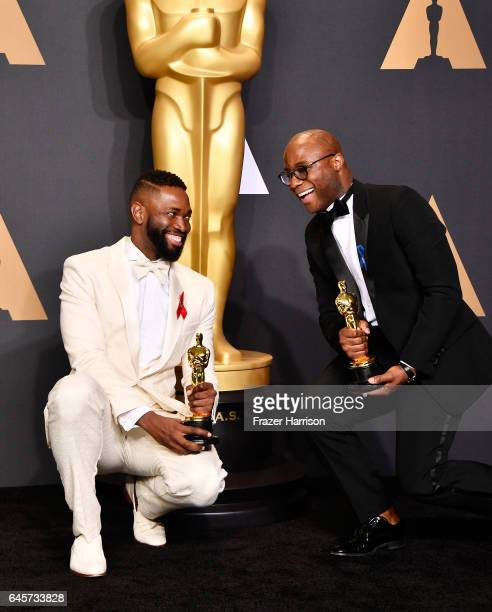 Screenwriter Tarell Alvin McCraney and writer/director Barry Jenkins winners of Best Adapted Screenplay for 'Moonlight' pose in the press room during...