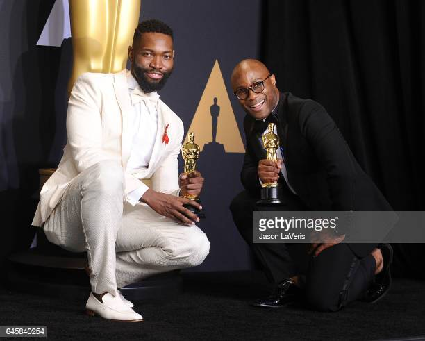Screenwriter Tarell Alvin McCraney and writer/director Barry Jenkins, winners of Best Adapted Screenplay for 'Moonlight', pose in the press room at...