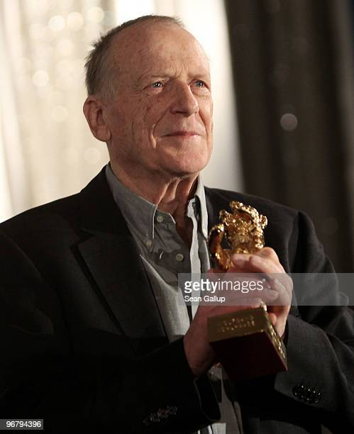 Screenwriter Wolfgang Kohlhaase holds up his Honorary Golden Bear after receiving the award at Kino International during the 60th Berlinale...