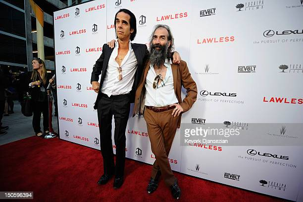 Screenwriter/composer Nick Cave and composer Warren Ellis arrive for the premiere of the Weinstein Company's Lawless at ArcLight Cinemas on August 22...