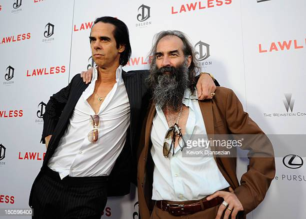 Screenwriter/composer Nick Cave and composer Warren Ellis arrive for the premiere of the Weinstein Company's 'Lawless' at ArcLight Cinemas on August...