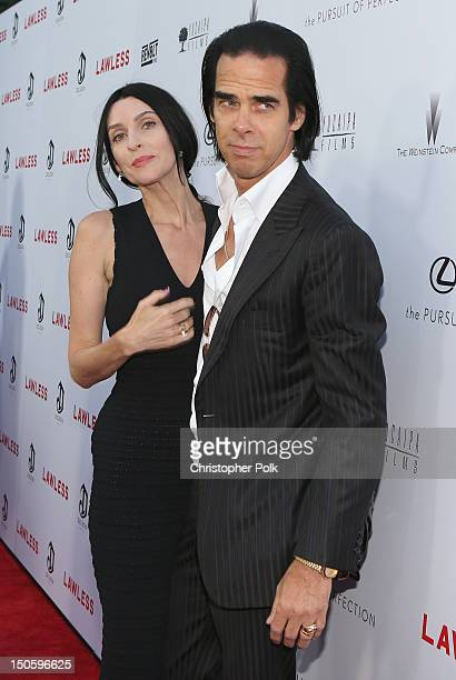 Screenwriter/composer Nick Cave and Susie Bick arrive at the premiere of The Weinstein Company's Lawless held at ArcLight Cinemas on August 22 2012...