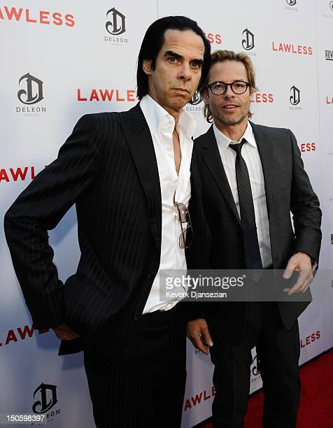 Screenwriter/composer Nick Cave cast member Guy Pearce arrive for the premiere of the Weinstein Company's Lawless at ArcLight Cinemas on August 22...