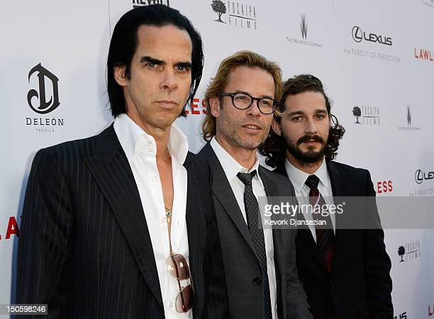 Screenwriter/composer Nick Cave cast members Guy Pearce and Shia LaBeouf arrive for the premiere of the Weinstein Company's Lawless at ArcLight...