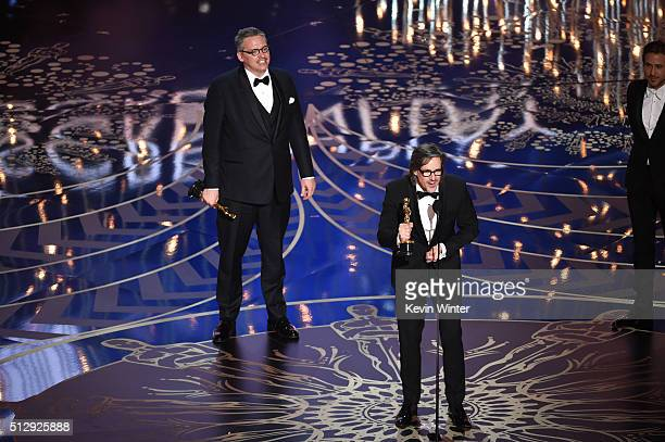 Screenwriterdirector Adam McKay and screenwriter Charles Randolph accept the Best Adapted Screenplay award for 'The Big Short' onstage during the...