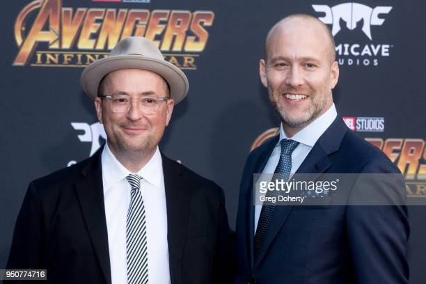 Screenwriters Christopher Markus and Stephen McFeely attend the Avengers Infinity War World Premiere on April 23 2018 in Los Angeles California