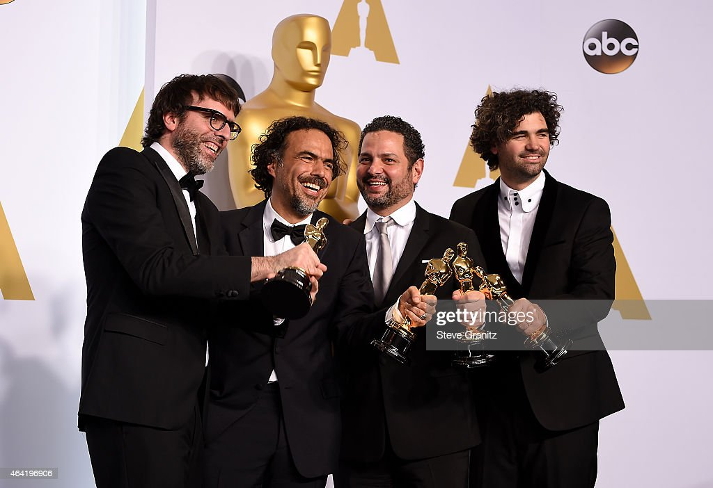 Screenwriters Nicolas Giacobone, Alejandro G. Inarritu, Alexander Dinelaris and Armando Bo pose in the press room during the 87th Annual Academy Awards at Loews Hollywood Hotel on February 22, 2015 in Hollywood, California.