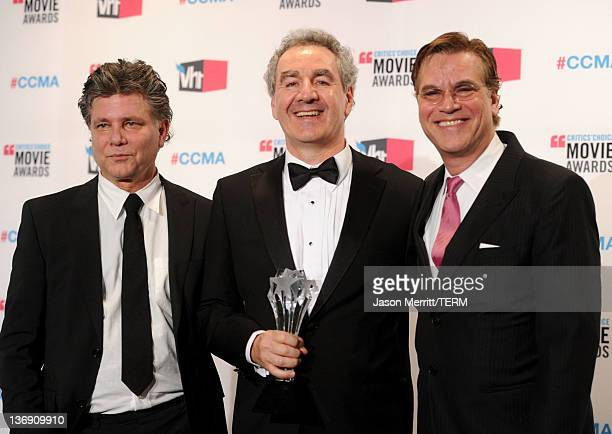 Screenwriters Steven Zaillian Stan Chervin and Aaron Sorkin winners of the Best Adapted Screenplay Award for Moneyball pose in the press room during...