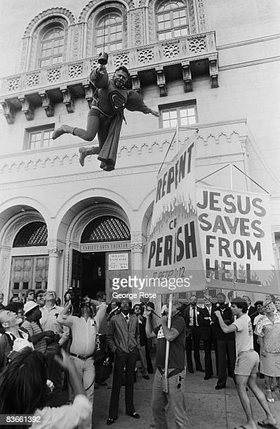 Screw Magazine publisher Al Goldstein entertains a crowd of onlookers outside the 1980 Hollywood California Adult Entertainment Awards held at the...