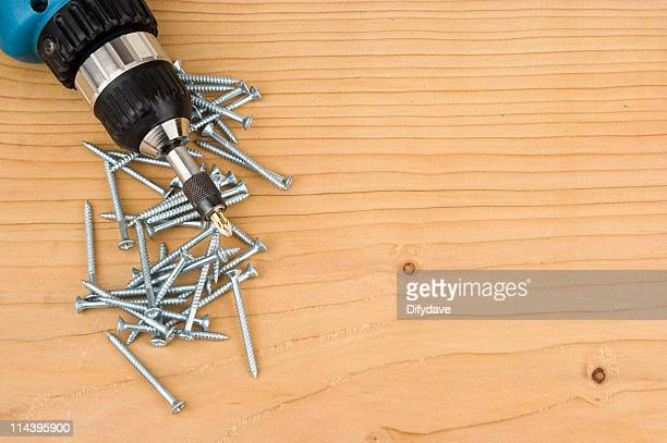 Screws And Drill Driver On Wood