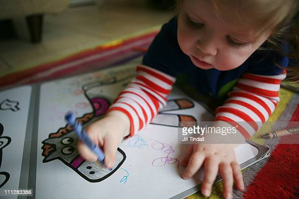 scribbling and colouring with crayons - colouring book stock photos and pictures