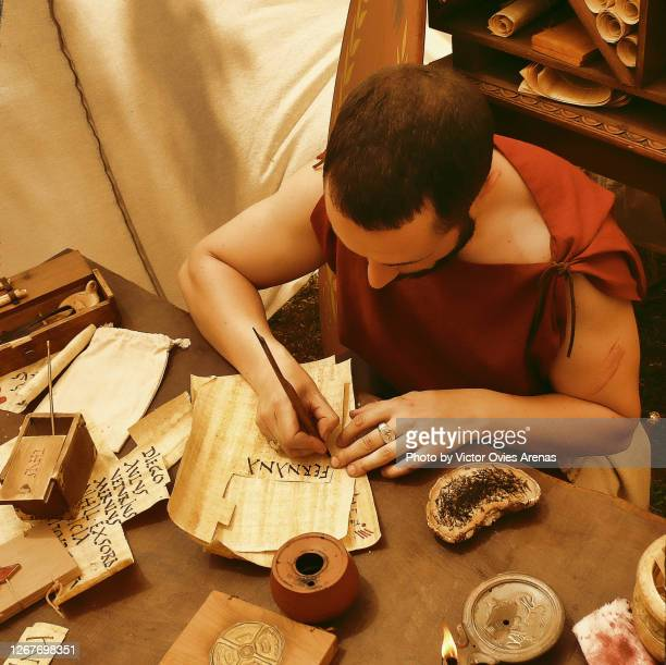 scribe from roman times in the arde lucus annual festival of historical reenactment - victor ovies fotografías e imágenes de stock