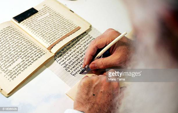 Scribe Samuel Wolfman writes a Torah at Congregation Chasam Sopher December 8 2004 in New York City High school students from Hebrew Academy of...
