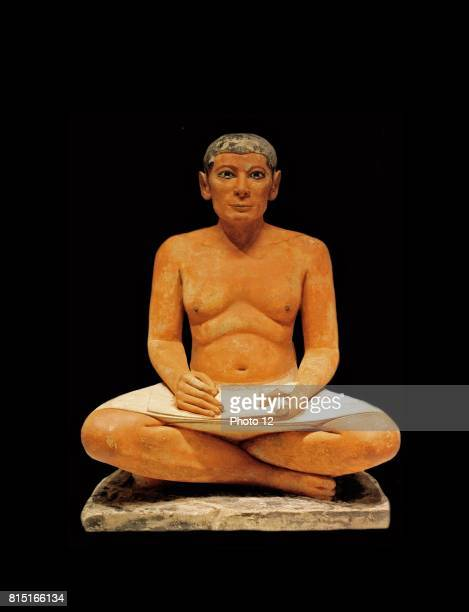 Scribe sitting crosslegged with a papyrus in his lap 2350 BC Egypt