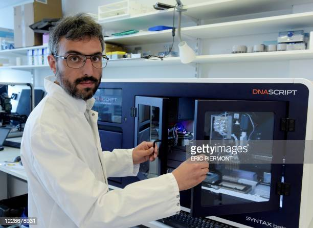 Script co-founder and CEO Thomas Ybert poses in front of DNA Script's world first benchtop DNA printer on August 28, 2020 in Kremlin-Bicetre, near...