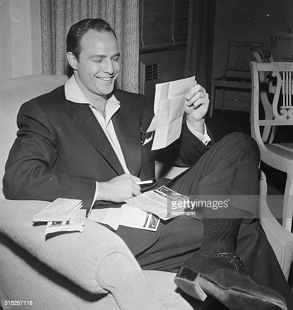 Scripts and movie cameras were put aside for the day shortly after Marlon Brando reported for work on the set of Guys and Dolls as the Academy Award...