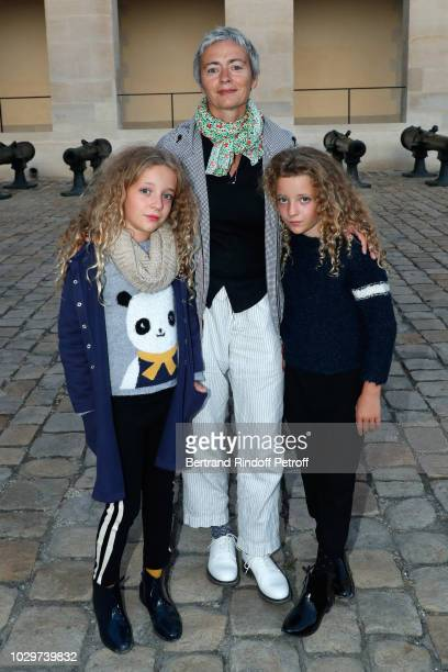 Scriptwriter Alexia Stresi with her twins Armele and Lucie attend the Triumph of 'Carmen Opera en Plein Air' performance at the Invalides during 4...