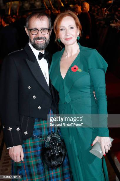 Scriptwriter and Producer of the movie JK Rowling and her husband Neil Michael Murray attend the Fantastic Beasts The Crimes of Grindelwald World...