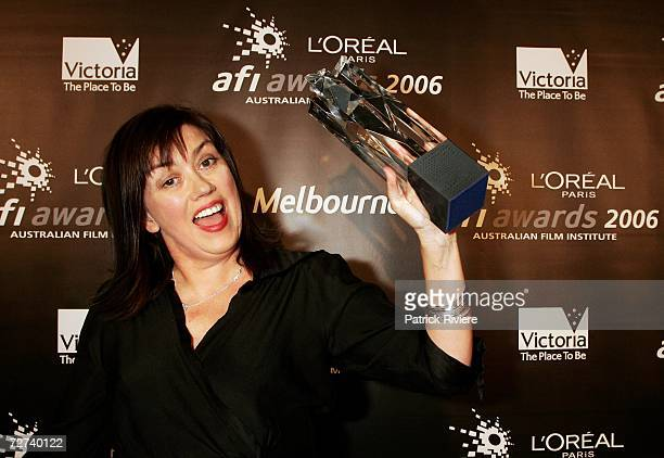 Scriptwriter Kathleen O'Brien poses in the awards room with the award for Best Screenplay in a Short Film at the L'Oreal Paris AFI 2006 Industry...